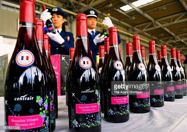 Custom officers inspect the first shipment of Beaujolais Nouveau arrived at Chubu International Airport on November 5 2013 in Tokoname Aichi Japan...