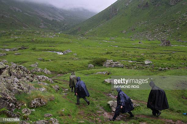Custom officers of AxlesThermes walk on a track during an operation monitoring the smuggling of cigarettes from the Principality of Andorra in the...