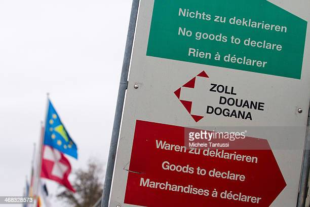 Custom Panel announces the border crossing between France Germany and Switzerland on February 10 2014 at Basel Switzerland Swiss citizens voted with...