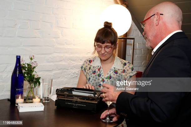 Custom poetry is written by Lisa Ann Markuson during the Bambini Furtuna Launch Brunch at The Little Owl Townhouse on January 14, 2020 in New York...