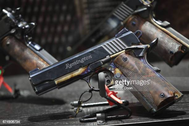 Custom Remington pistols are displayed at the 146th NRA Annual Meetings Exhibits on April 29 2017 in Atlanta Georgia With more than 800 exhibitors...