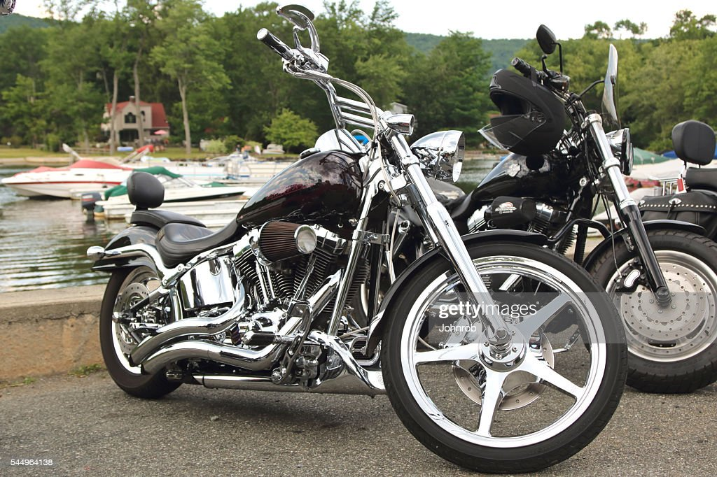 Custom Softail Harley Davidson Motorcycle Parked At Lakeside