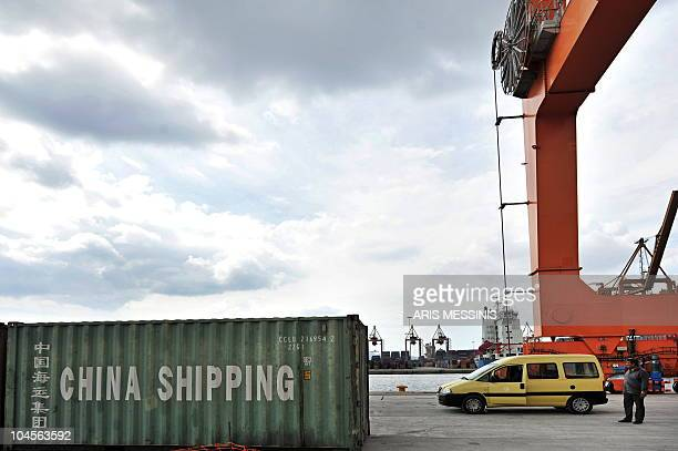 A custom worker stands next to a container at the port of Piraeus near Athens in this picture taken on September 24 2010 In request of foreign funds...