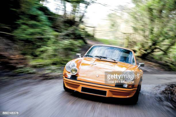 A custombuilt Porsche 911 RSR sports car with a Signal Orange finish photographed on a country road in Dorset England on February 7 2017
