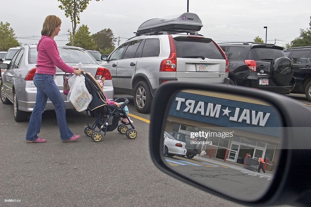 Customer Amy Palmer returns to her car outside a Danvers