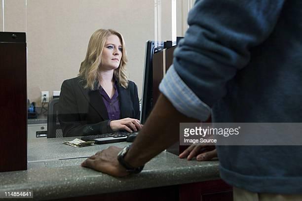 Customer and bank teller