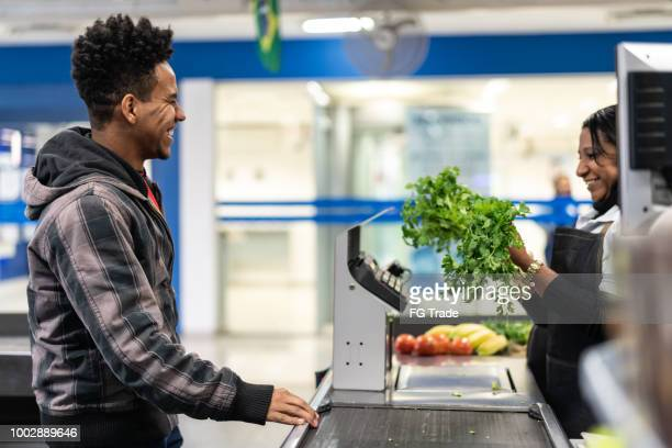 Customer and Cashier in checkout at Supermarket