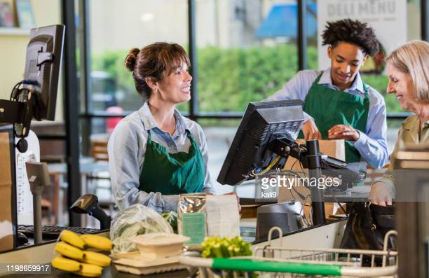 customer and employees at supermarket checkout - checkout stock pictures, royalty-free photos & images