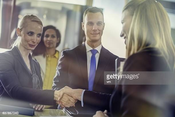 Customer and insurance agent shaking hands
