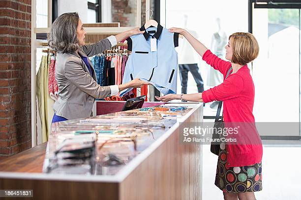 Customer and sales clerk at boutique counter