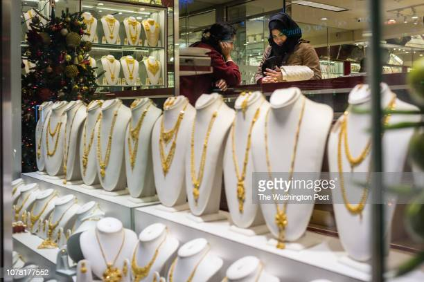 A customer and salesperson are seen in a jewelry shop owned and operated by immigrants from India Tuesday December 18 in Jackson Heights New York It...