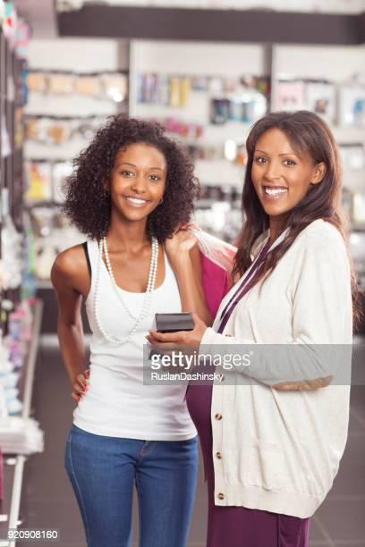 Customer and seller women at make-up shop.