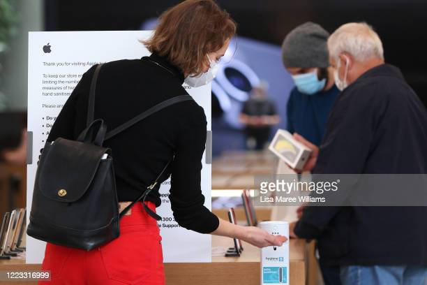Customer applies hand sanitiser on entering the Apple Store at Bondi Junction on May 07, 2020 in Sydney, Australia. Apple stores across Australia...