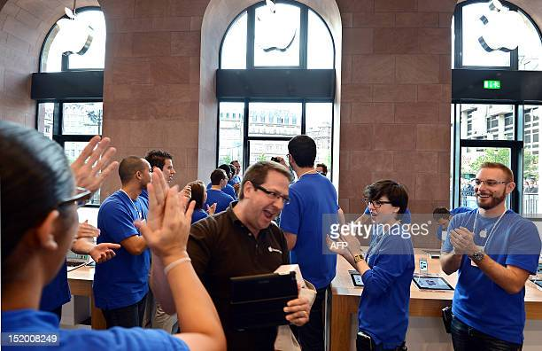 A customer arrives for the inauguration of a new Apple store in Strasbourg eastern France on September 15 2012 AFP PHOTO / PATRICK HERTZOG