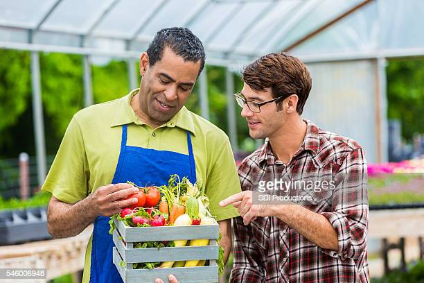 Customer asks farmer questions about produce