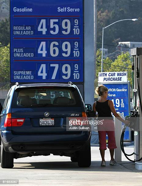 A customer at a Chevron gasoline station prepares to pump fuel into her car July 14 2008 in Mill Valley California As gasoline prices continue to...