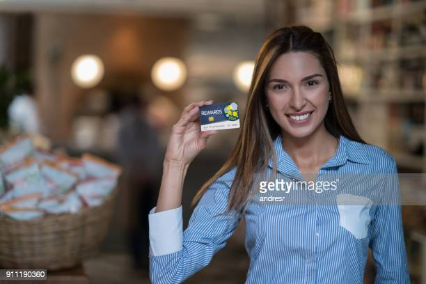 Customer at a grocery shop holding a rewards card