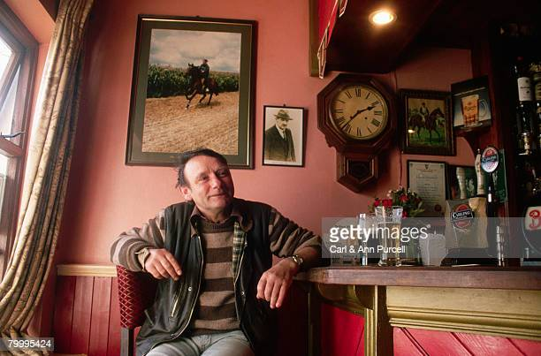 customer at a pub - irish pub stock photos and pictures