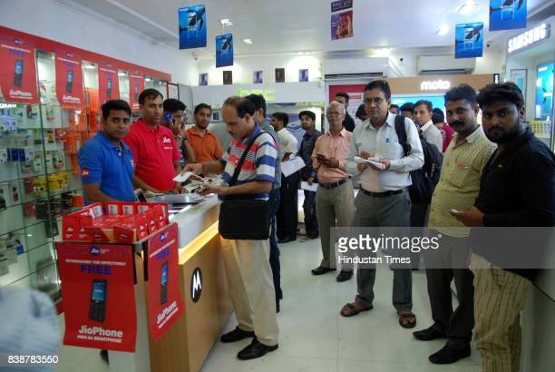 Customer at Reliance store for jio phone prebooking at Connaught Place on August 24 2017 in New Delhi India Prebooking for Reliance Jio Phone starts...