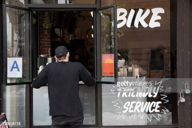 customer at service window, nike and coffee shop, new york, usa - sportgeschäft stock-fotos und bilder