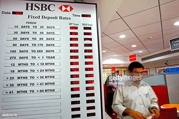 A customer at the HSBC Bank branch in New Delhi India walks past a chart that displays Fixed Deposit rates Friday June 4 2004