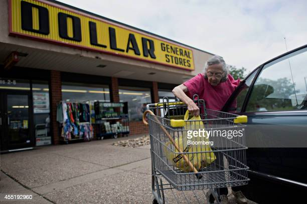 Customer Betty McGrath places purchases in the backseat of her vehicle outside a Dollar General Corp store in Silvis Illinois US on Wednesday Sept 10...