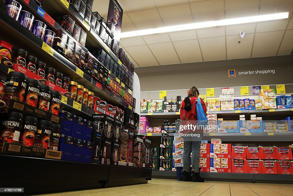 A customer browses a display of snacks at an Aldi Stores Ltd  food