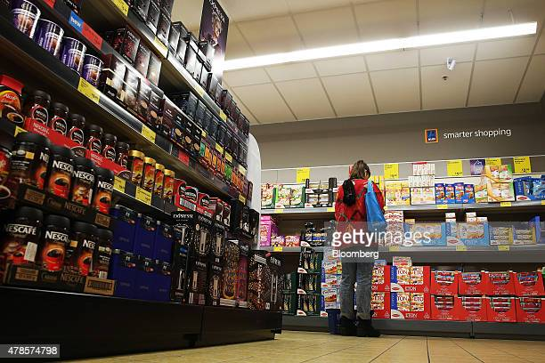 A customer browses a display of snacks at an Aldi Stores Ltd food store in Sydney Australia on Thursday June 25 2015 Australia's biggest supermarkets...