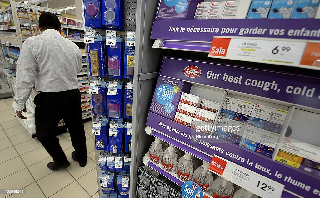 A customer browses at a Shoppers Drug Mart Corp. store in Toronto, Ontario, Canada, on Monday, Feb. 4, 2013. Shoppers Drug Mart Corp., Canada's largest pharmacy chain, is scheduled to release earnings data on Feb. 7. Photographer: Aaron Harris/Bloomberg via Getty Images