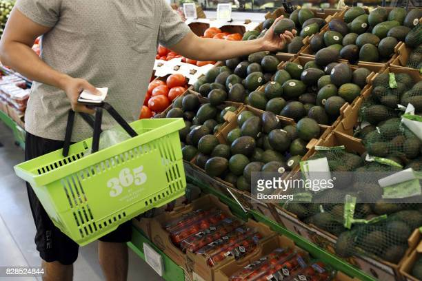 A customer browses avocados during the grand opening of a Whole Foods Market 365 location in Santa Monica California US on Wednesday Aug 9 2017 The...