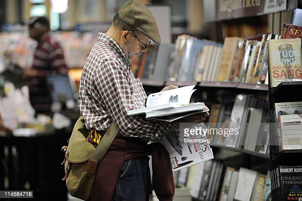 A customer browses books in a Barnes Noble Inc store in New York US on Tuesday May 24 2011 Barnes Noble Inc the target of a $1 billion bid from...