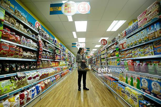 A customer browses breakfast cereal products at a Poundland Group Plc store in Leigh UK on Thursday Feb 4 2016 UK like for like sales at midmarket...