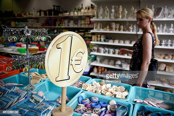 A customer browses budget priced goods for sale inside a one euro store in Athens Greece on Friday July 17 2015 Germany's Parliament is set to ratify...