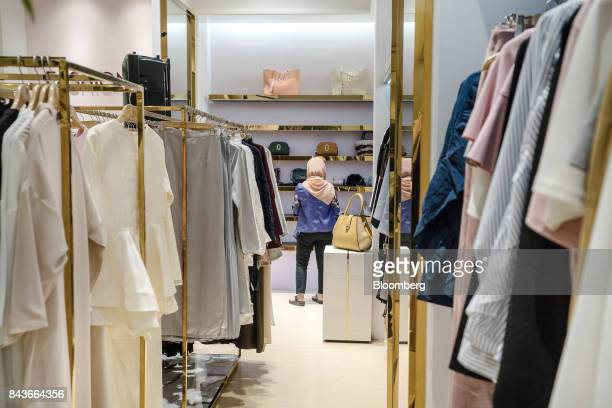A customer browses clothing and accessories at the FashionValet Sdn store in Kuala Lumpur Malaysia on Tuesday June 20 2017 FashionValet Cofounder...