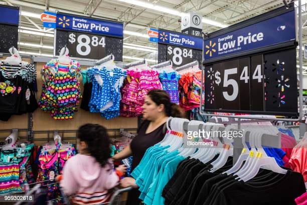 A customer browses clothing at a Walmart Inc store in Secaucus New Jersey US on Wednesday May 16 2018 Walmart is scheduled to release earnings...