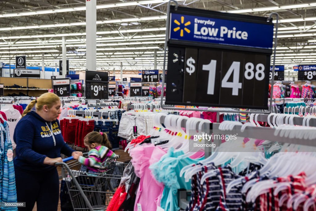 A customer browses clothing at a Walmart Inc. store in Secaucus, New Jersey, U.S., on Wednesday, May 16, 2018. Walmart is scheduled to release earnings figures on May 17. Photographer: Timothy Fadek/Bloomberg via Getty Images