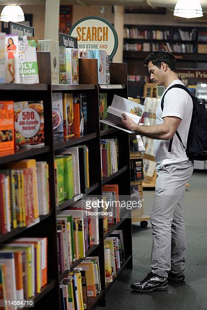 A customer browses cookbooks in a Barnes Noble Inc store in New York US on Tuesday May 24 2011 Barnes Noble Inc the target of a $1 billion bid from...