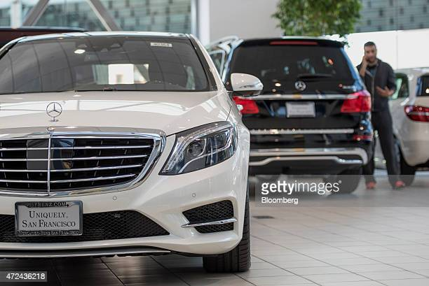A customer browses Daimler AG MercedesBenz vehicles at the MercedesBenz of San Francisco dealership in San Francisco California US on Wednesday May 6...