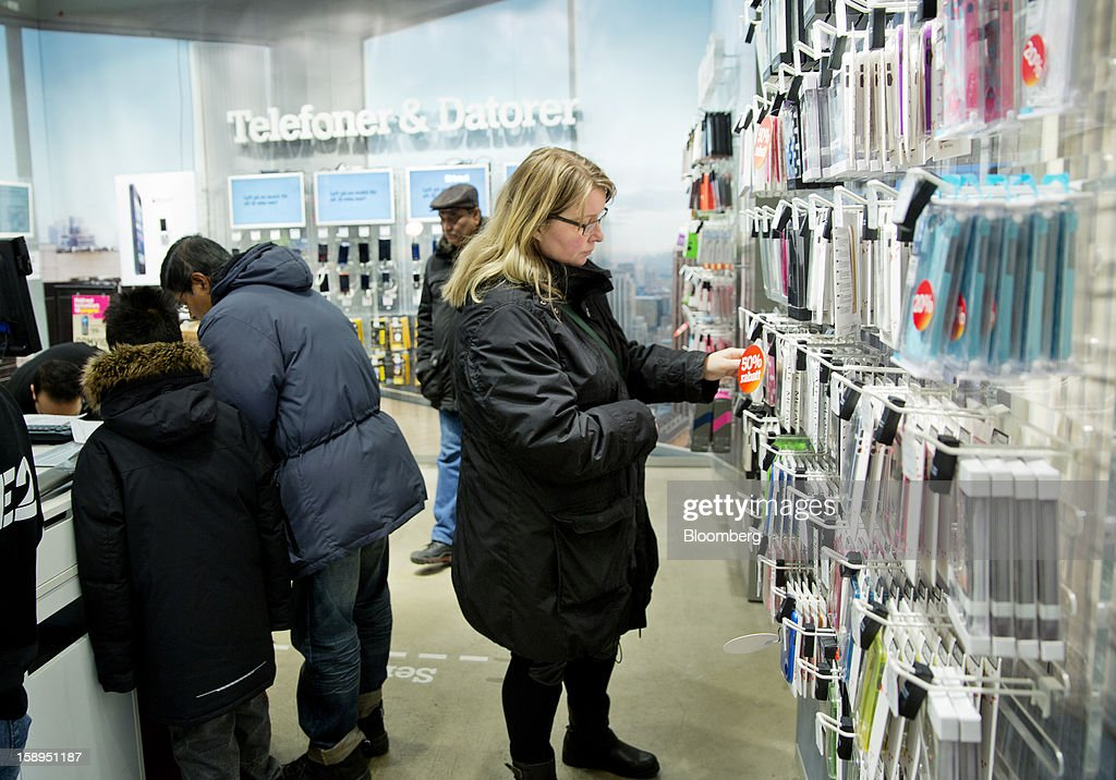 A customer browses discounted mobile handset accessories for sale at a Tele2 AB retail store inside the Farsta Centrum shopping center in Stockholm, Sweden, on Friday, Jan. 4, 2013. OAO Rostelecom's largest owner after the Russian state, Konstantin Malofeev, is urging the country's dominant fixed-line operator to buy the local unit of Sweden's Tele2 AB to form a fourth nationwide wireless carrier. Photographer: Casper Hedberg/Bloomberg via Getty Images