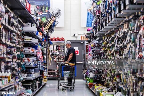 A customer browses fishing supplies at a Walmart Inc store in Secaucus New Jersey US on Wednesday May 16 2018 Walmart is scheduled to release...