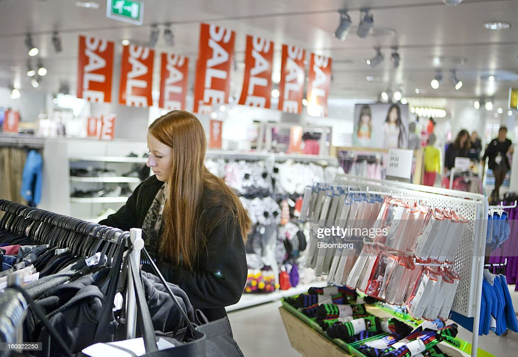 A customer browses garments for sale inside a Hennes & Mauritz AB (H&M) store in Stockholm, Sweden, on Tuesday, Jan. 29, 2013. Hennes & Mauritz AB, Europe's second-largest clothing retailer, reported sales growth that beat analysts' estimates for a second consecutive month as the chain offered markdowns in advance of the Christmas holiday. Photographer: Casper Hedberg/Bloomberg via Getty Images