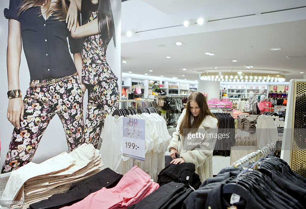 A customer browses garments on display inside a Hennes & Mauritz AB (H&M) store in Stockholm, Sweden, on Tuesday, Jan. 29, 2013. Hennes & Mauritz AB, Europe's second-largest clothing retailer, reported sales growth that beat analysts' estimates for a second consecutive month as the chain offered markdowns in advance of the Christmas holiday. Photographer: Casper Hedberg/Bloomberg via Getty Images