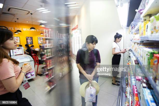 A customer browses goods on display at a 7Eleven store in Ho Chi Minh City Vietnam on Wednesday June 20 2018 For decades Vietnamese have shopped...