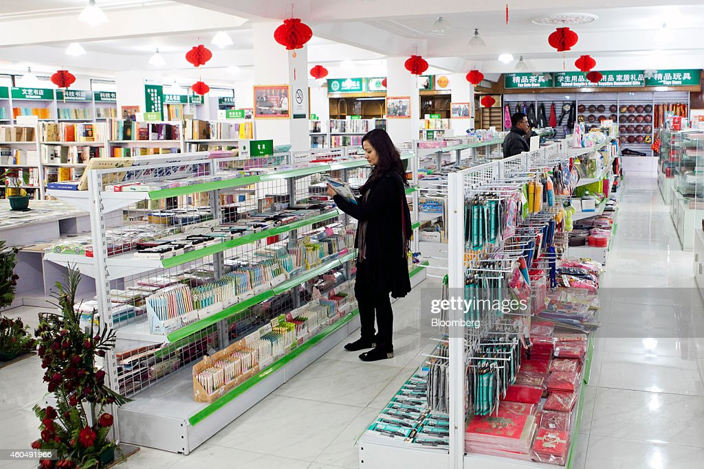 A customer browses inside Chinese-language bookstore Xinzhi