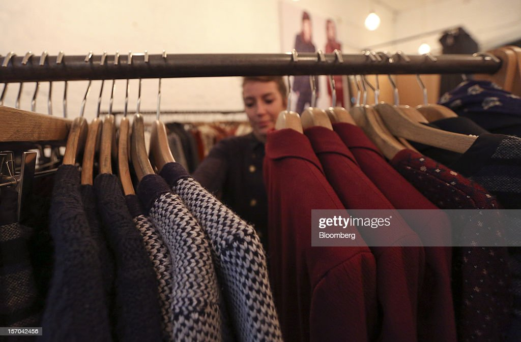 A customer browses ladies' clothes inside a NW3 store, a brand of Hobbs and former pop-up store, in London, U.K., on Tuesday, Nov. 27, 2012. Fashion chain Hobbs is among those that have opened pop-up stores for the first time this year, while CD and DVD retailer HMV Group Plc is adding more than usual for the holiday in an effort to win business. Photographer: Chris Ratcliffe/Bloomberg via Getty Images