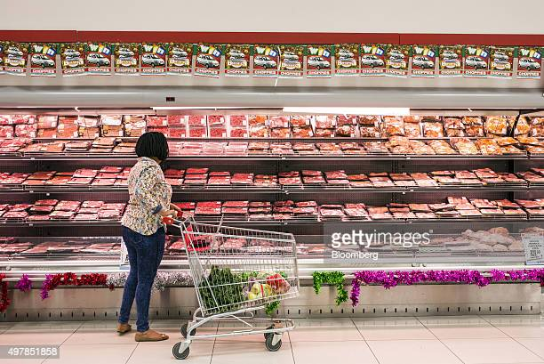 A customer browses meat in a refrigerated section inside a Choppies supermarket operated by Choppies Enterprises Ltd in Rustenburg South Africa on...