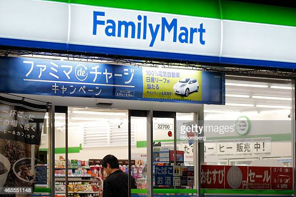 A customer browses merchandise at a FamilyMart Co convenience store in Tokyo Japan on Saturday March 7 2015 FamilyMart and Uny Group Holdings Co are...