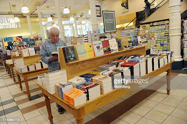 A customer browses nonfiction books in a Barnes Noble Inc store in New York US on Tuesday May 24 2011 Barnes Noble Inc the target of a $1 billion bid...