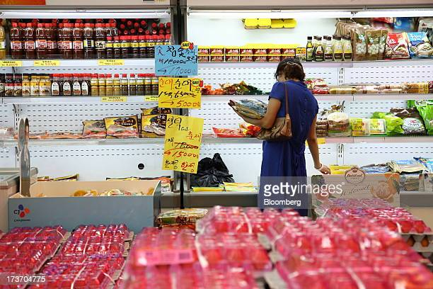 Customer browses packaged food in a store at Noeun Agricultural and Marine Products Wholesale Market in Daejeon, South Korea, on Tuesday, July 16,...