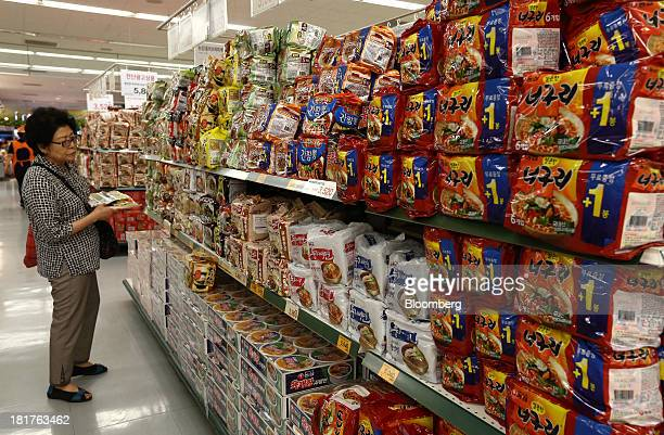 A customer browses packages of instant ramen noodles at an EMart Co store a subsidiary of Shinsegae Co in Seoul South Korea on Tuesday Sept 24 2013...
